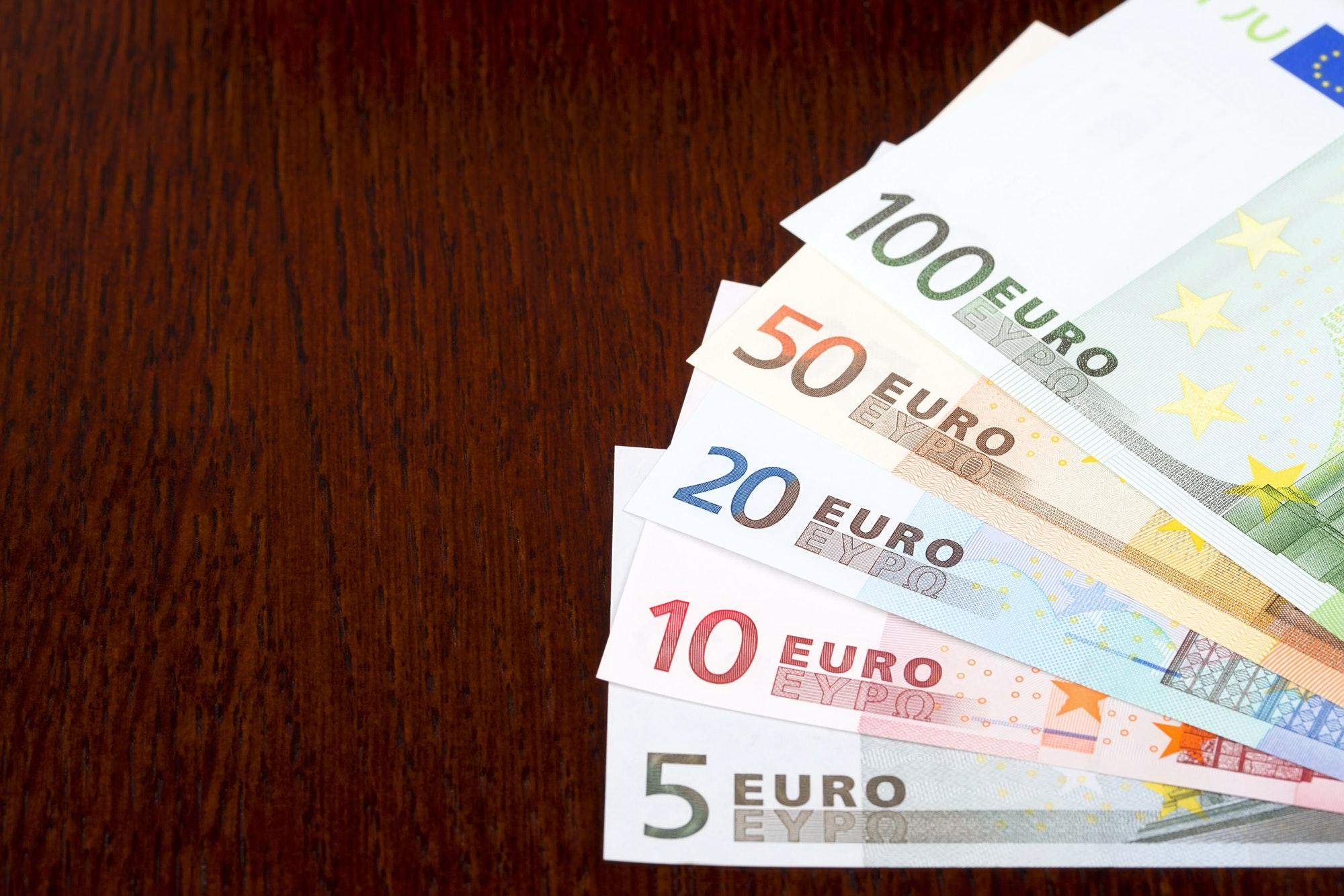 European money on a wooden background