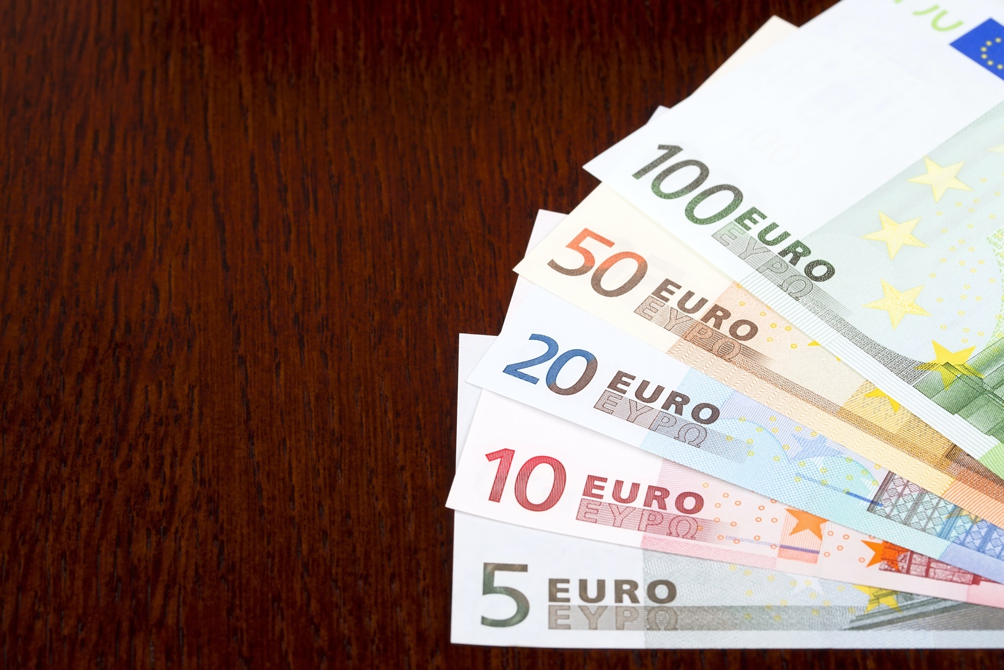 European money on a wooden background